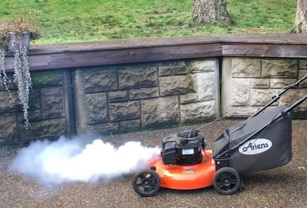 Lawn-mower-burning-oil-with-white-smoke